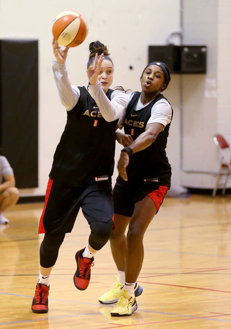 Las Vegas Aces guard Kayla McBride (21) passes around Jackie Young during practice at Cox Pavil ...