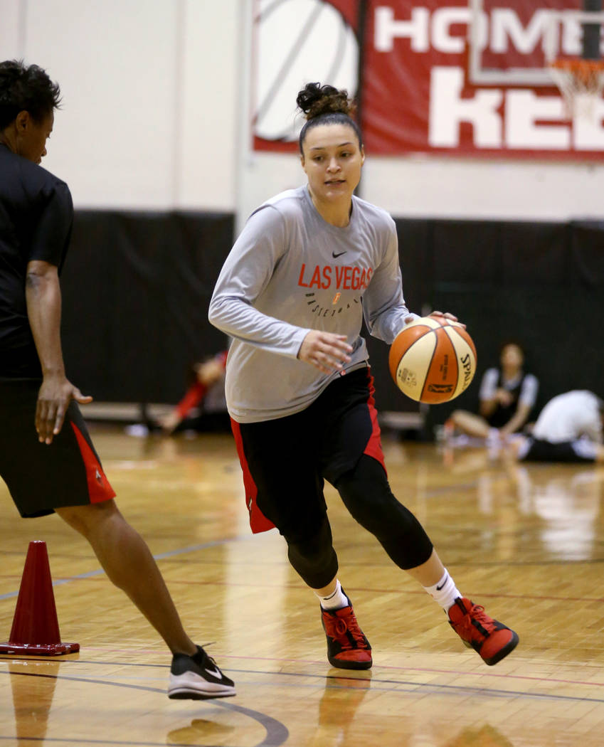 Las Vegas Aces guard Kayla McBride (21) runs a drill with Assistant Coach Vickie Johnson after ...