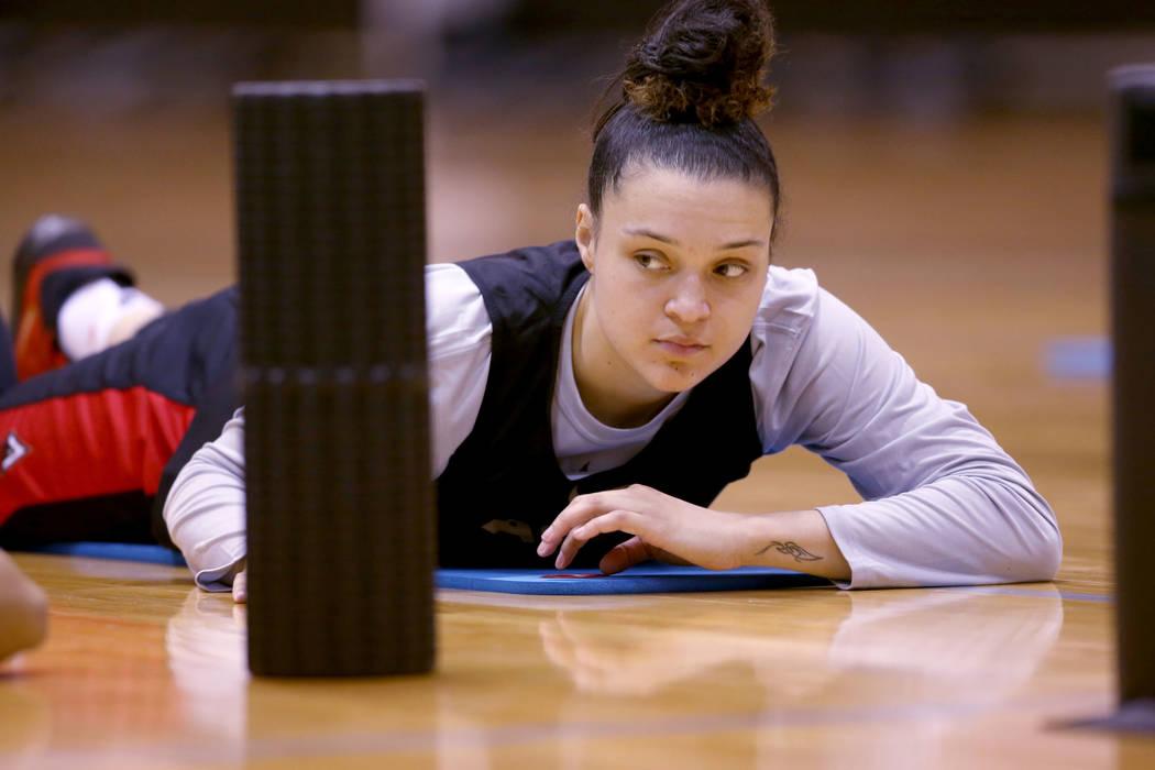 Las Vegas Aces guard Kayla McBride (21) stretches before practice at Cox Pavilion in Las Vegas ...