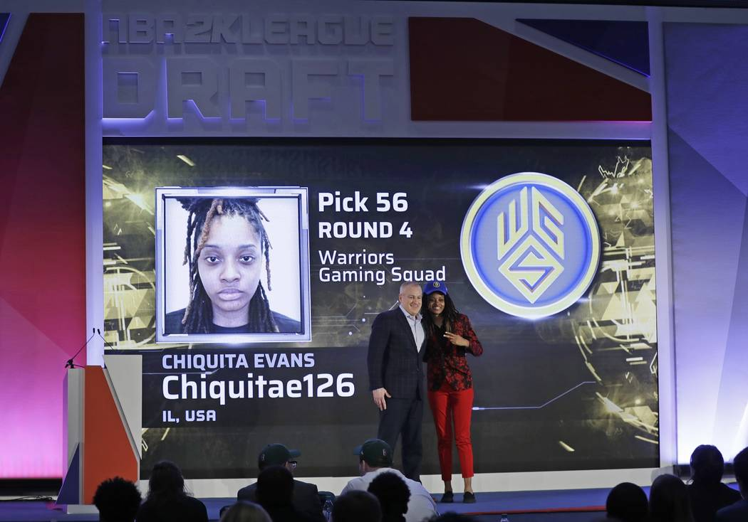 Chiquita Evans poses for photographs with Brendan Donohue after being selected as the 56th pick ...