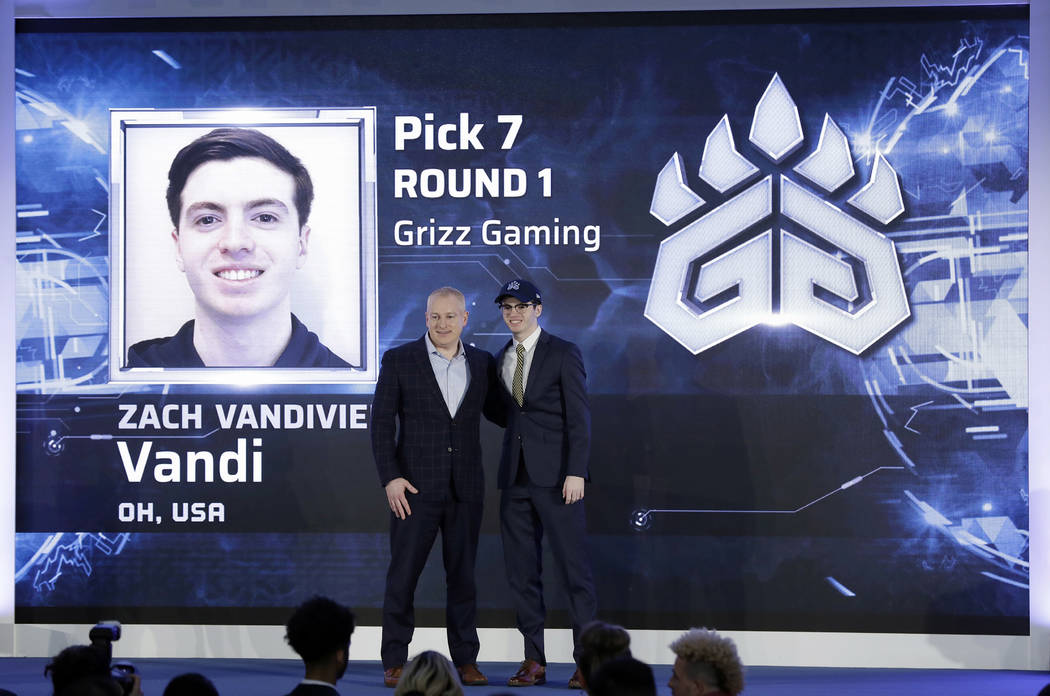 Brendan Donohue, managing director of the new NBA 2K esports league, left, poses for photograph ...