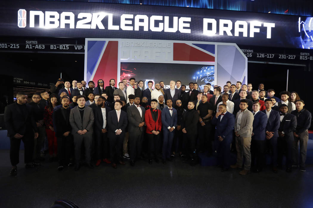 Brendan Donohue, managing director of the new NBA 2K esports league, center, poses for photogra ...