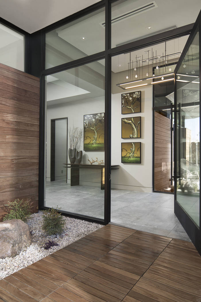 The front door opens to luxury that is reminiscent to Australian modern architecture. (Studio G ...