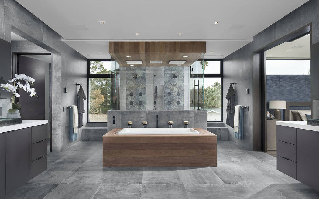 The master bath has a modern, but warm feel. (Studio G Architecture)