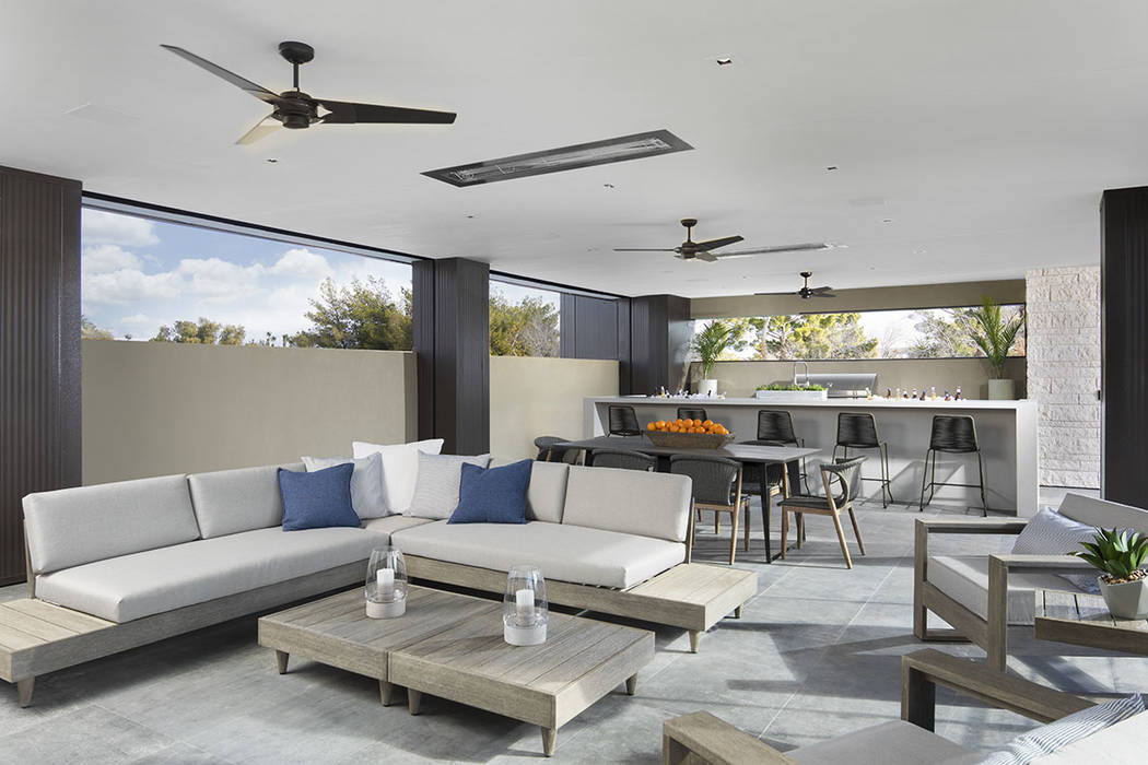 An outdoor kitchen is located upstairs and is connected to the master suite. (Studio G Architec ...