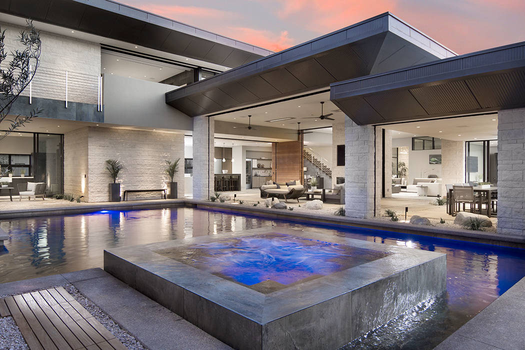 The pool is in the center courtyard that grounds the home. (Studio G Architecture)