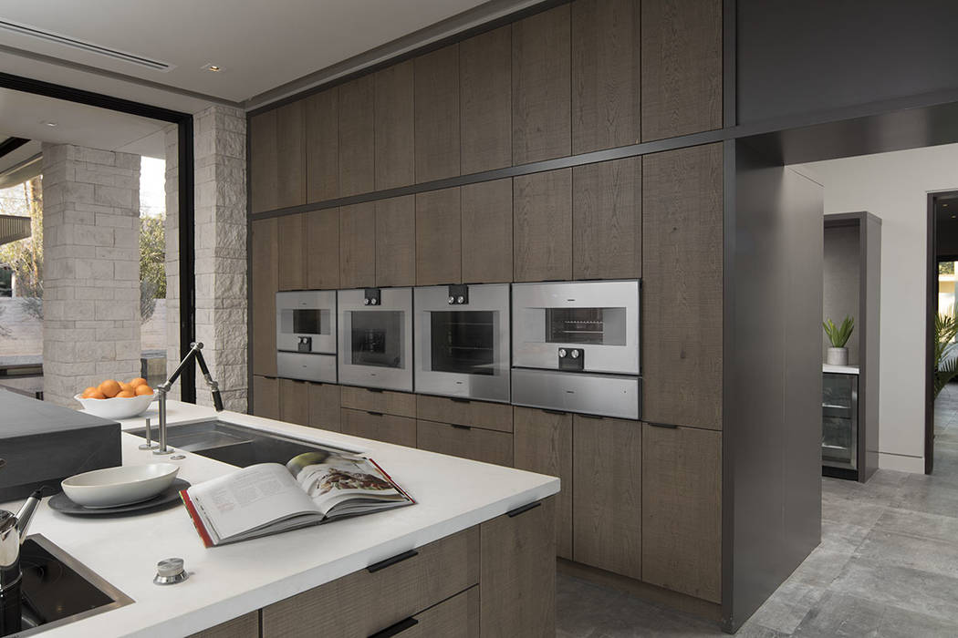 The kitchen features four ovens, which are designed for different uses. (Studio G Architecture)