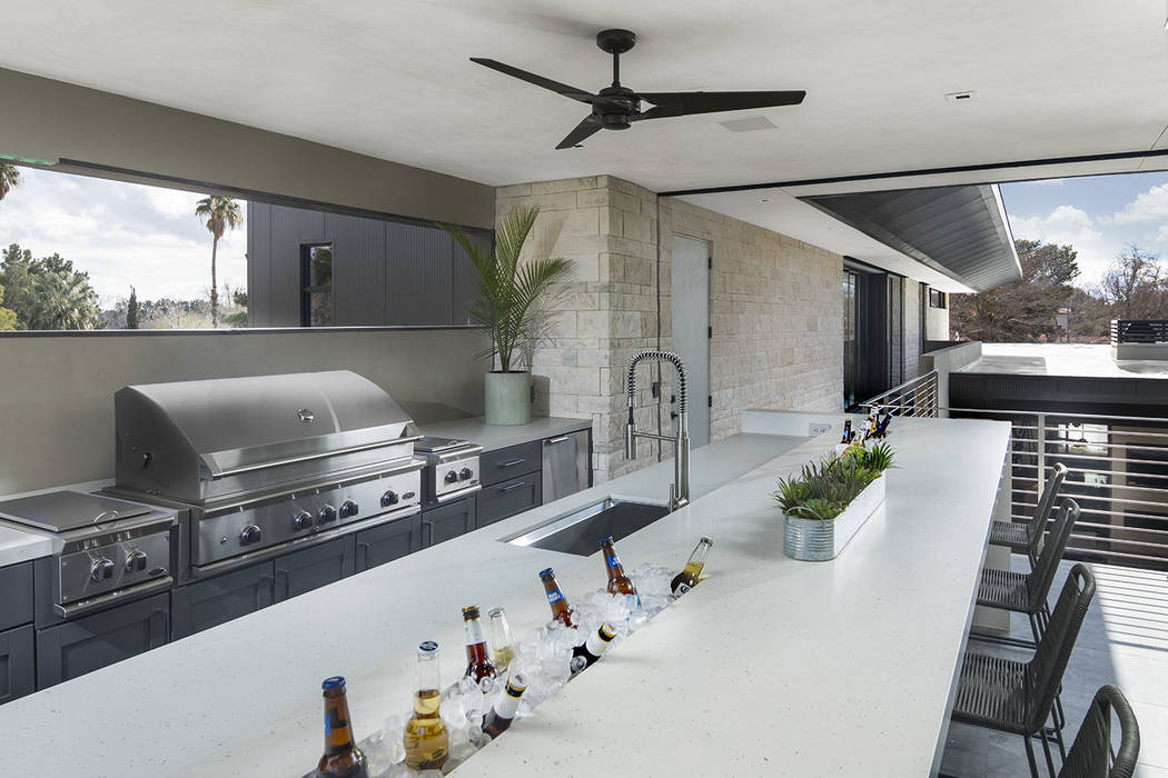 A good place to grill for company is the second-story outdoor kitchen. (Studio G Architecture)