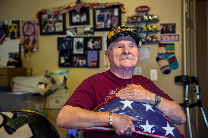 Ret. Chief Master Sgt. Clifford Smith, a Vietnam War veteran, holds a military burial flag in h ...