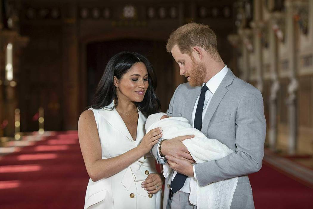Britain's Prince Harry and Meghan, Duchess of Sussex, during a photocall with their newborn son ...