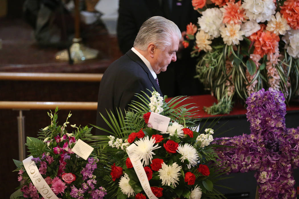 Nevada Gov. Steve Sisolak walks after speaking during the funeral service for Assemblyman Tyron ...