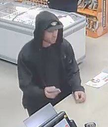 Las Vegas police are asking for help finding a man suspected of robbing a business at gunpoint ...