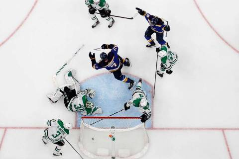 St. Louis Blues' Pat Maroon (7) and Robert Thomas (18) celebrate a score by Maroon, as Dallas S ...