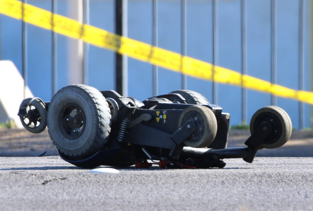 A motorized wheelchair is seen at the scene of a fatal crash at Boulder Highway and Sunset Road ...