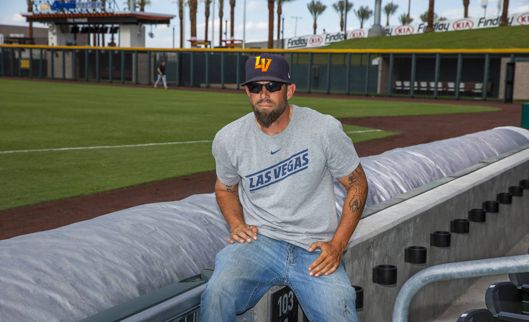 The Aviators head groundskeeper Collin Doebler with their new field tarp at Las Vegas Ballpark, ...