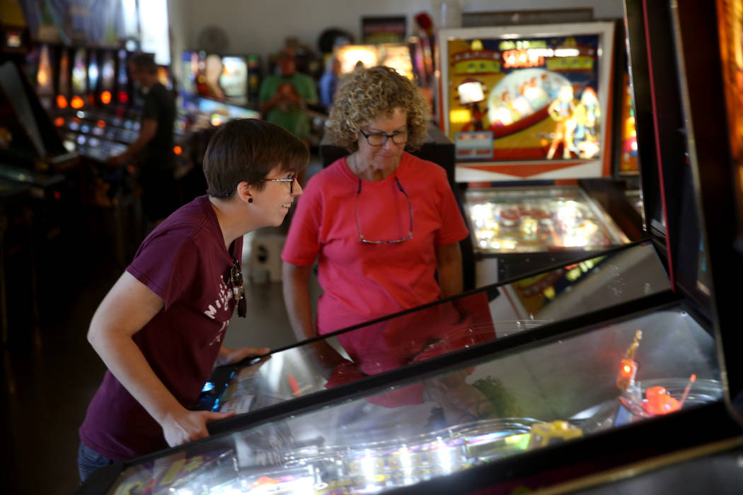 Summer Bradshaw, 28, and her mother LaDean Bradshaw of Kansas City play a pinball machine at th ...