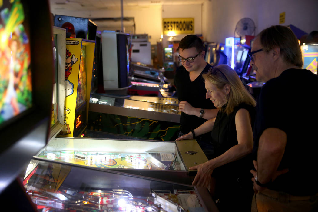 Sherry Smith, her son Elvis, 23, and husband Duane of Lancaster, Pennsylvania, play a pinball m ...