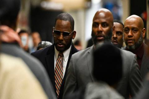 Musician R. Kelly arrives at the Daley Center for a hearing in his child support case Wednesday ...