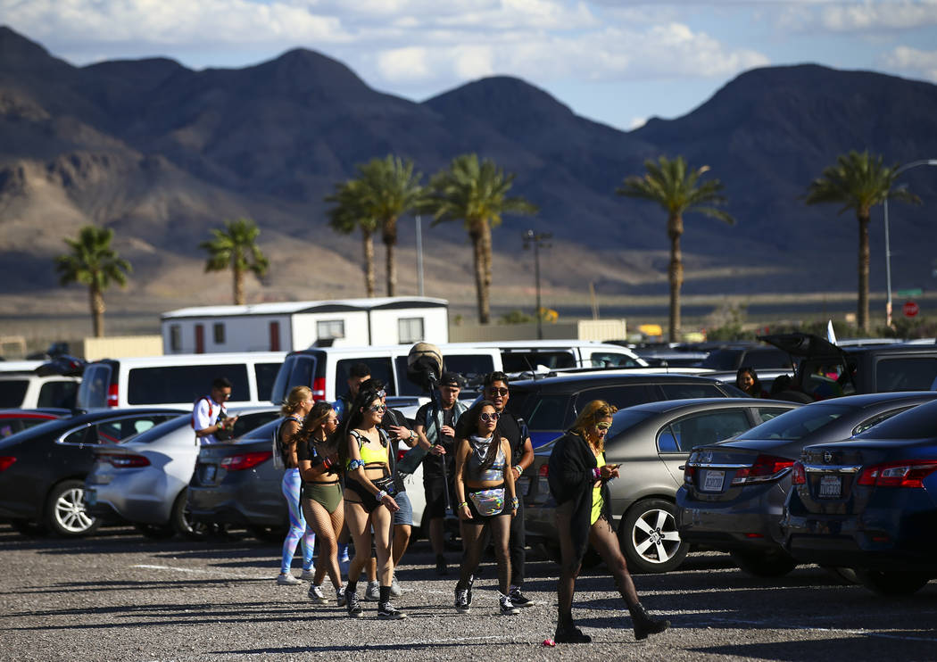 Electric Daisy Carnival attendees make their way to the Las Vegas Motor Speedway in Las Vegas o ...