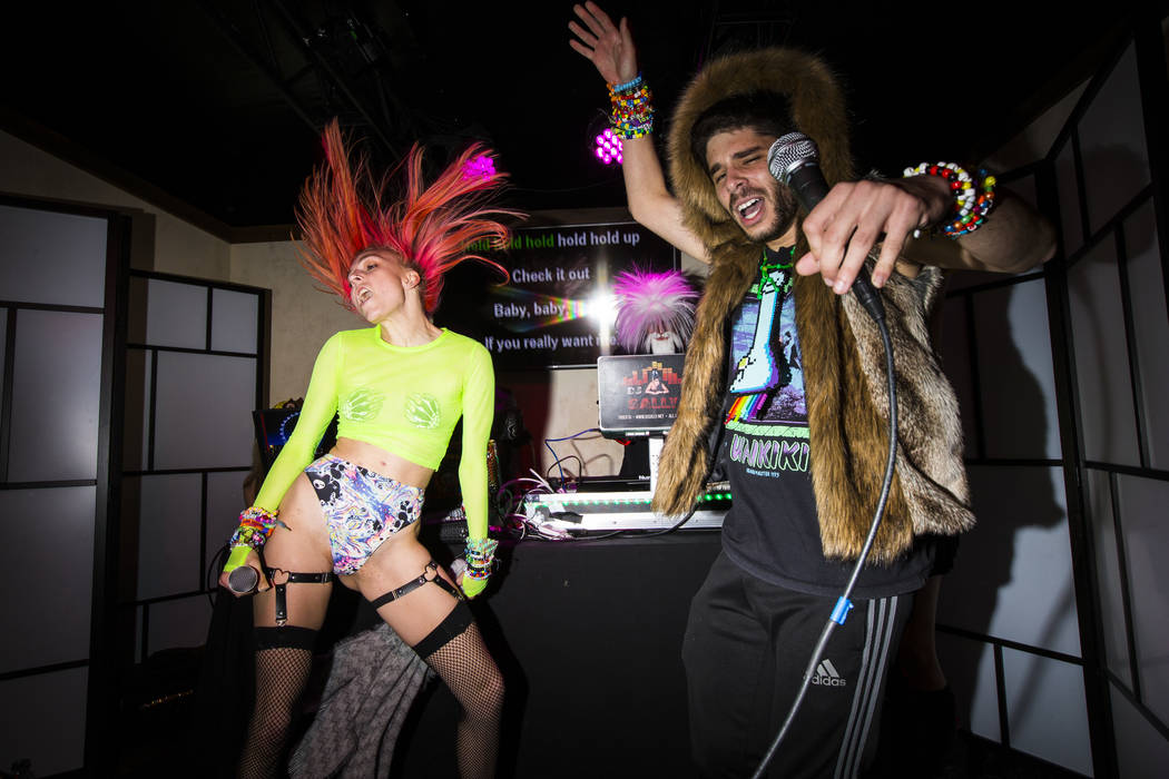 Carley Baltes, left, and Joseph Kleid, of San Francisco, perform at the karaoke bar at the Down ...
