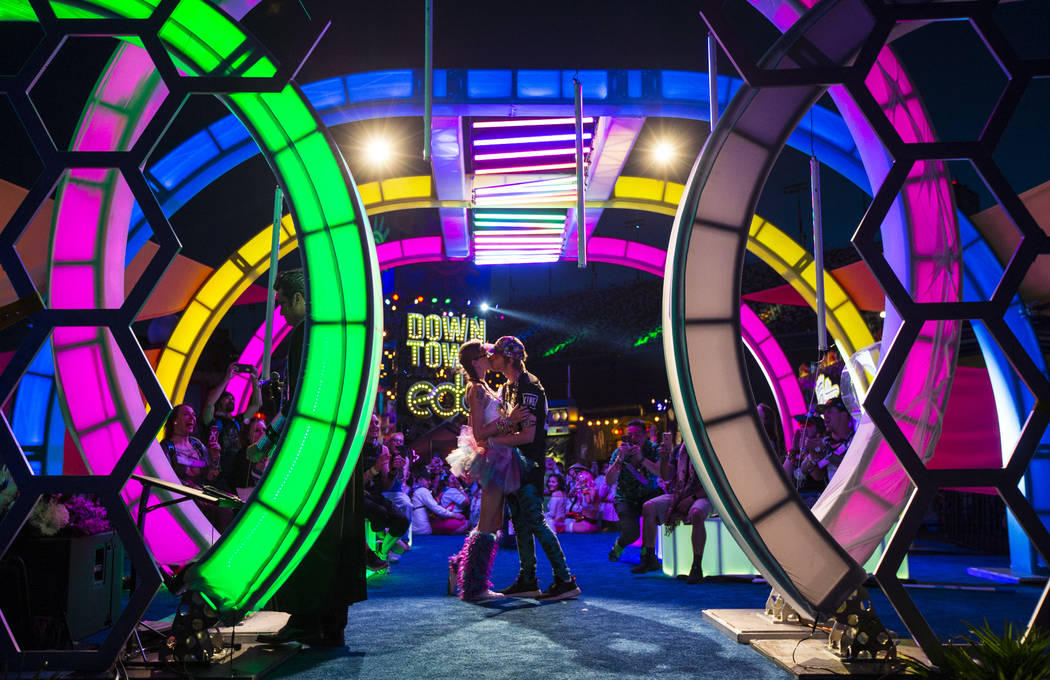 Jessye Tolmich, left, and Dakota Tolmich, both of Denver, kiss during their wedding ceremony on ...