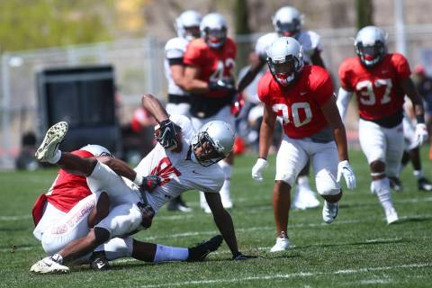 UNLV Rebels wide receiver Patrick Ballard (85) is taken down by running back Tyree Jackson duri ...