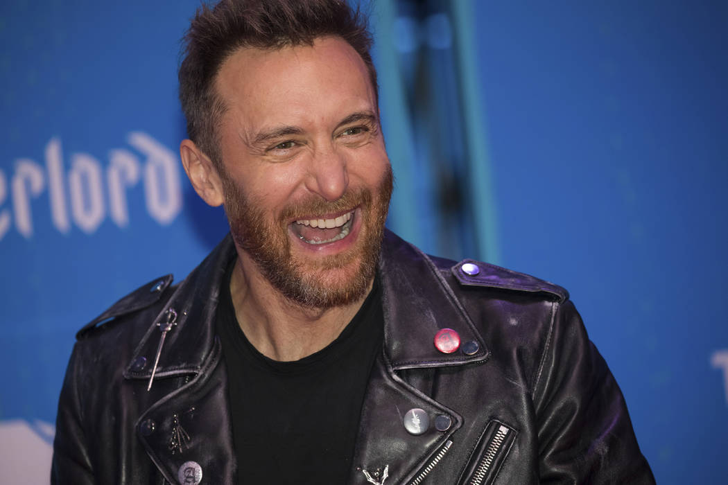 DJ David Guetta poses for photographers upon arrival at the European MTV Awards in Bilbao, Spai ...