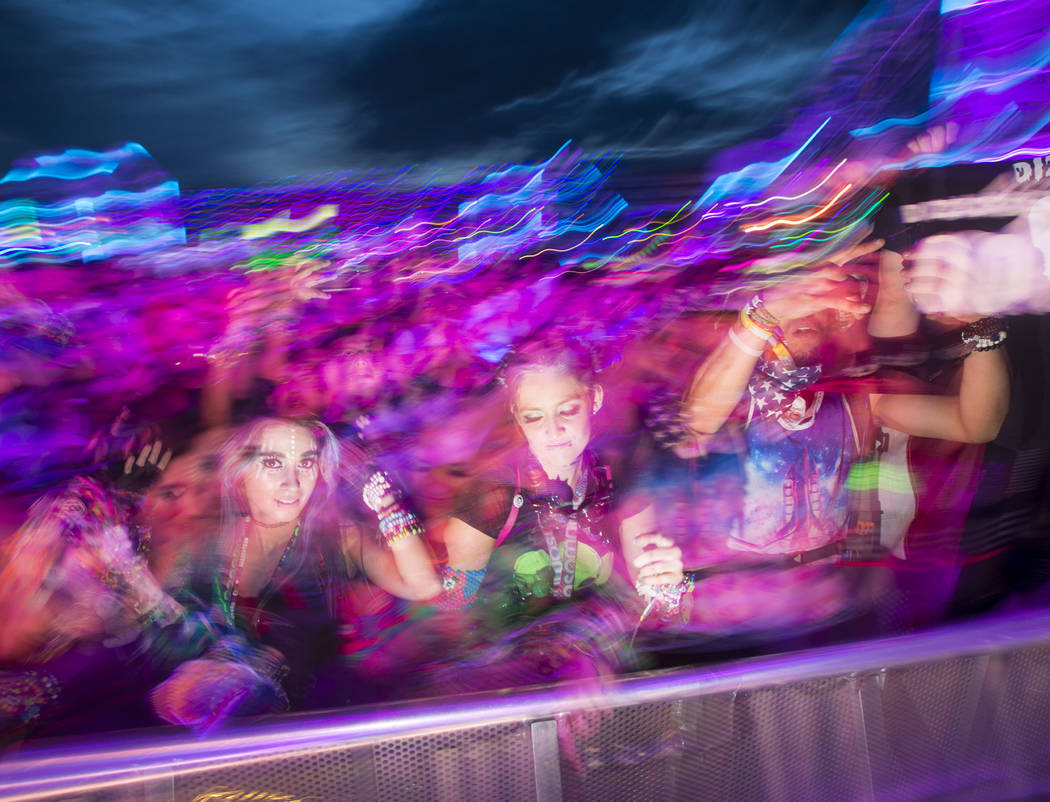 Attendees dance as Dateless performs at the Stereobloom stage during the third day of the Elect ...