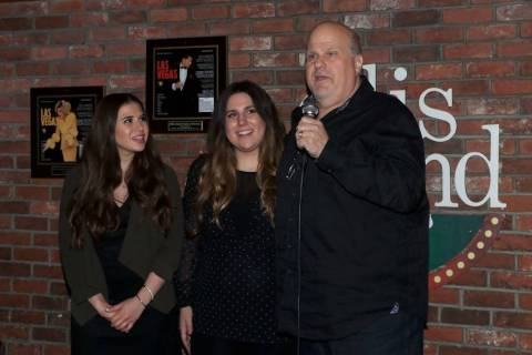 "Gary Ellis and his daughters Christina and Annamarie Ellis are shown at ""Sing For Strength,"" a ..."