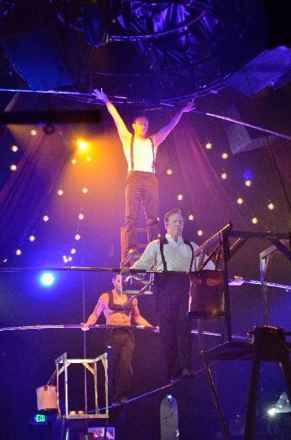 Almas Meirmanov, left, Tony Hernandez, center, and Paul Matthew Lopez perform as the Esteemed G ...