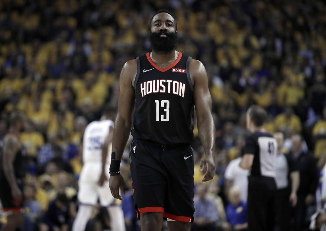 Houston Rockets' James Harden (13) walks downcourt during the first half of Game 5 of the team' ...