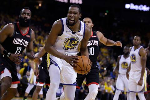 Houston Rockets' James Harden, left, and Golden State Warriors' Kevin Durant (35) react to a re ...