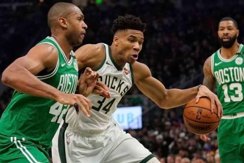 Milwaukee Bucks' Giannis Antetokounmpo tries to drive past Boston Celtics' Al Horford during th ...