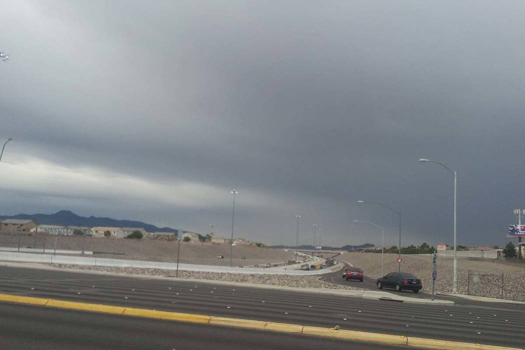 Dark clouds are seen from the 215 Beltway and Windmill Lane in the south part of the Las Vegas ...