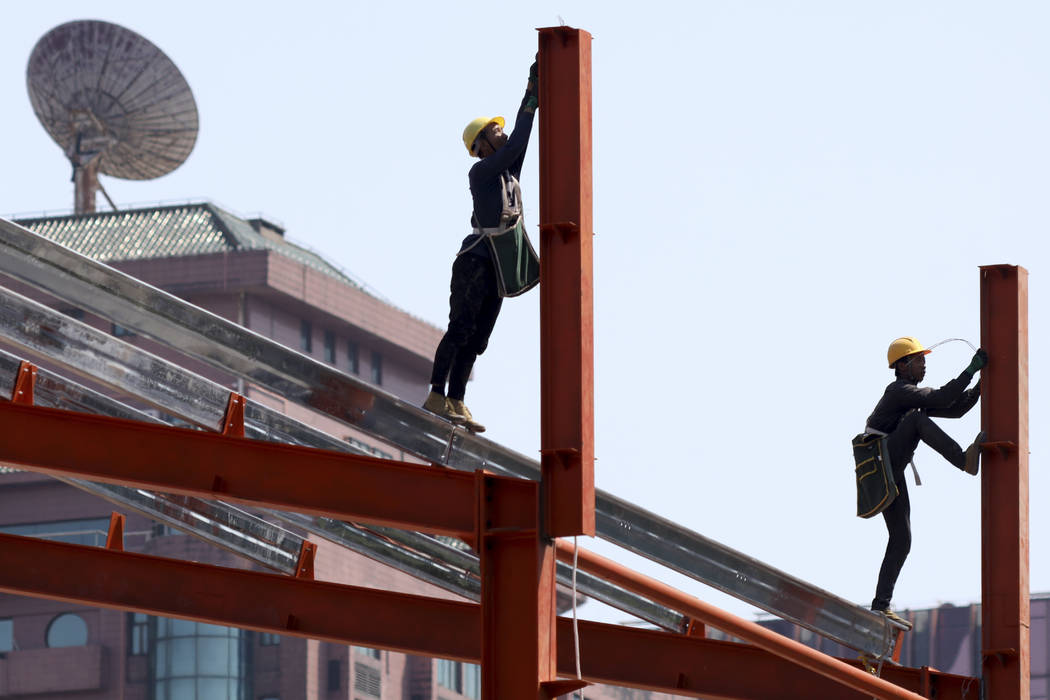 Workers labor in downtown Beijing on Thursday, May 9, 2019. The U.S. effort to win concessions ...