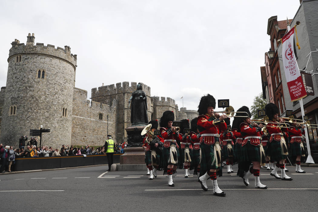 The Royal Regiment of Scotland band march by Windsor Castle, in Windsor, south England, Tuesday ...