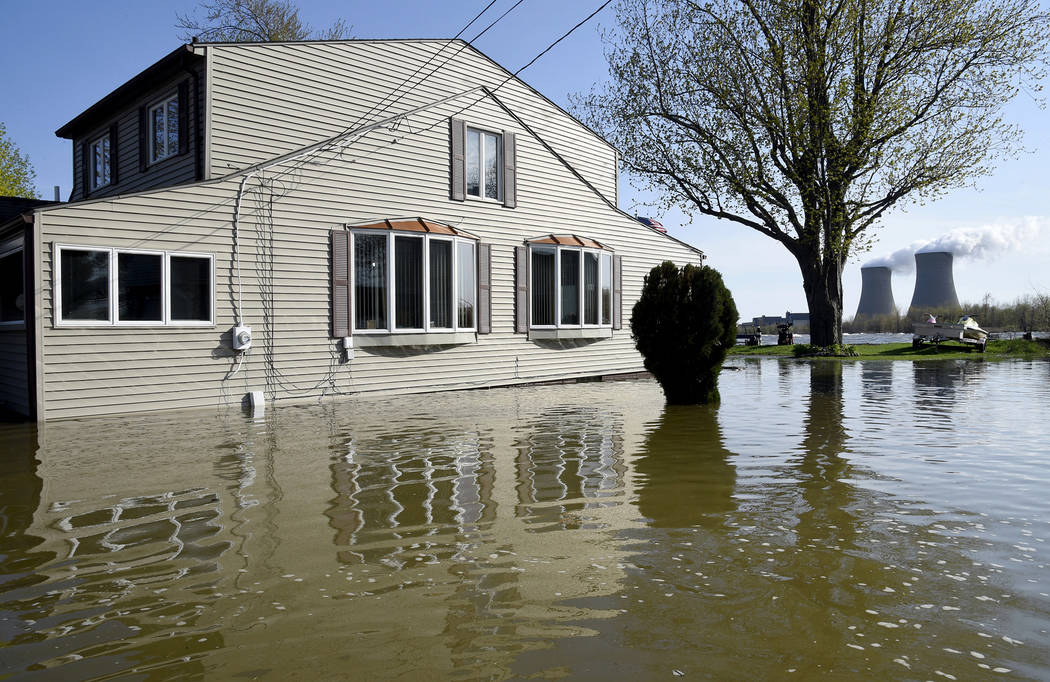 In this Wednesday, May 8, 2019 photo, a home surrounded by water on Lakeshore Dr. in the south ...