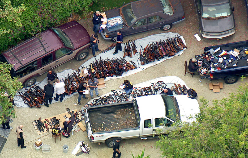 Investigators from the U.S. Bureau of Alcohol, Tobacco, Firearms and Explosives and the police ...