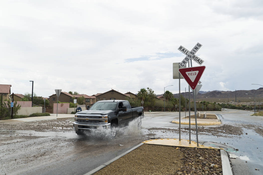 Mud and debris can end up on the roadway during heavy rains. (Las Vegas Review-Journal)
