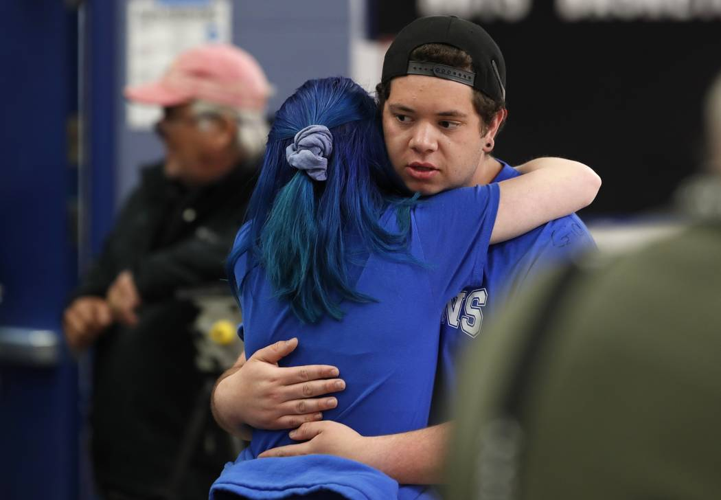 Audrey Glenn, left, hugs Andrew Schoenherr, a student at the STEM School Highlands Ranch, durin ...