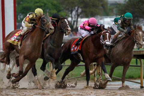 In this May 4, 2019, file photo, Flavien Prat on Country House, left, races against Luis Saez o ...
