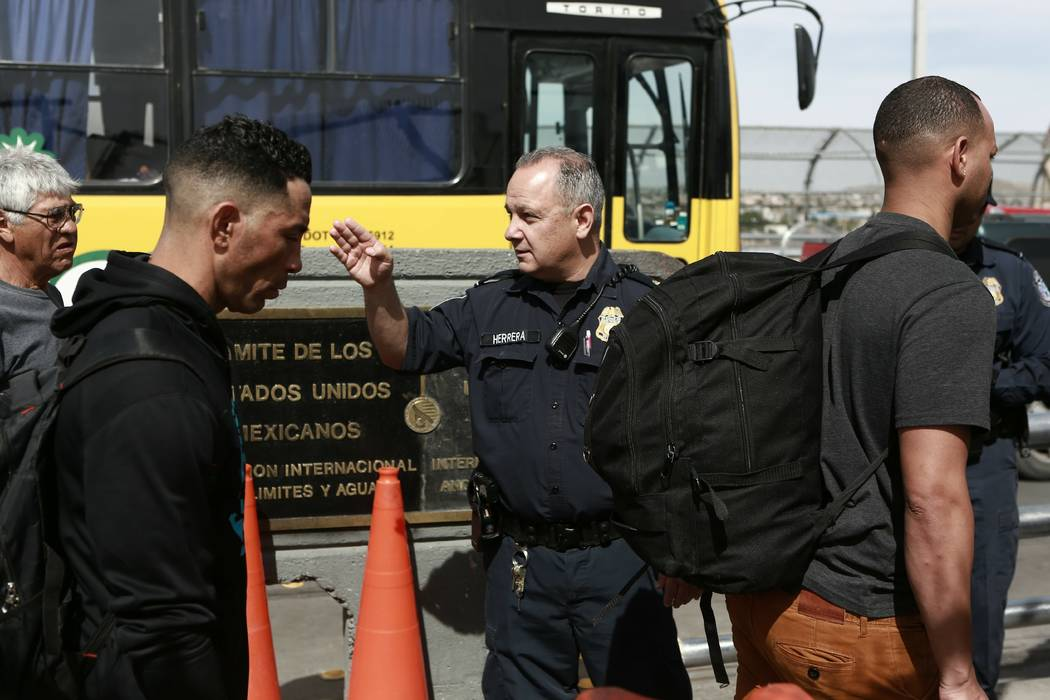 Cuban migrant are escorted by Mexican immigration officials in Ciudad Juarez, Mexico, on April ...