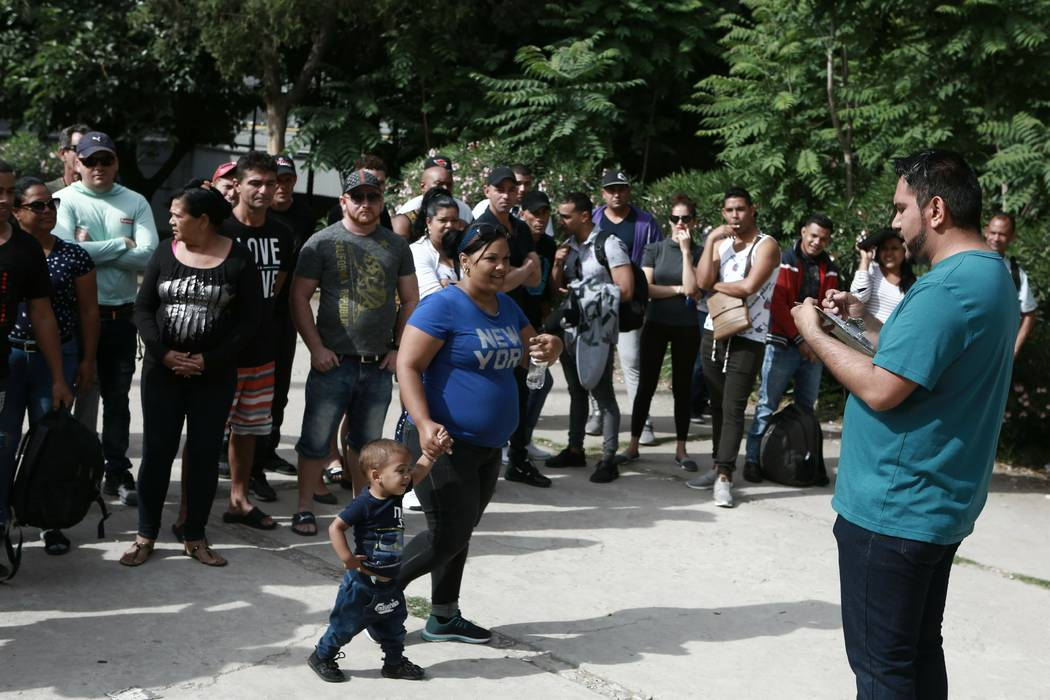 Cuban migrants are registered by Mexican immigration officials in Ciudad Juarez, Mexico, on Apr ...
