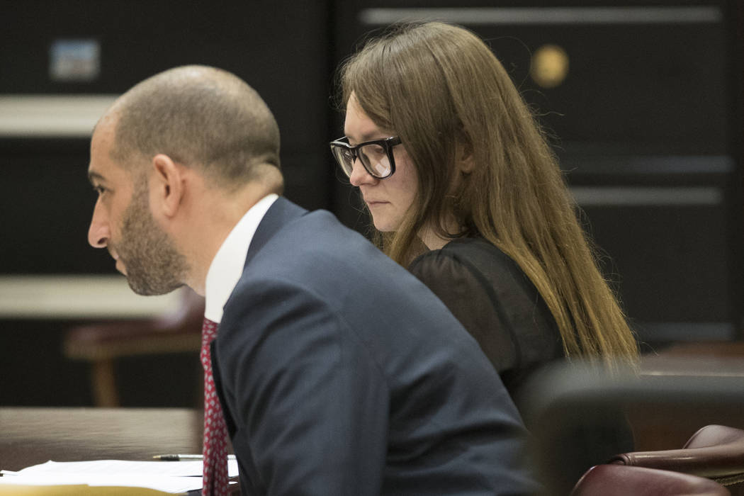 In this April 25, 2019, file photo, Anna Sorokin, right, and her lawyer Todd Spodek react as th ...