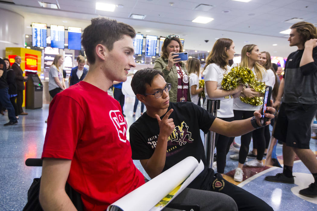 Faith Lutheran senior Mark Wilbourne, left, takes a selfie with Steve Mascella during a welcome ...