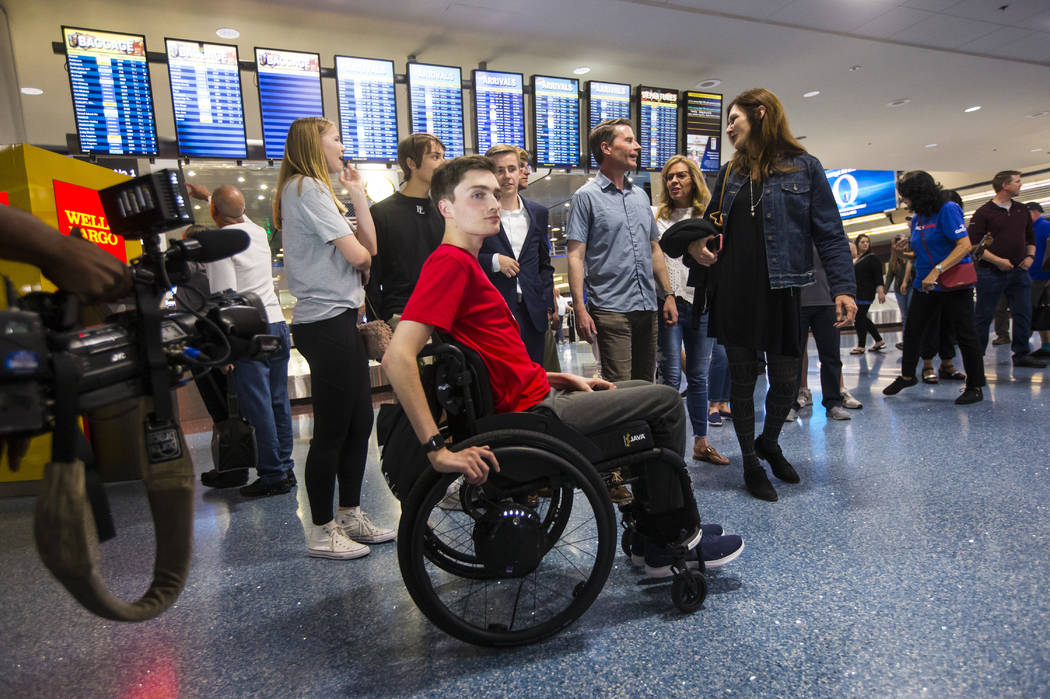 Faith Lutheran senior Mark Wilbourne, in red, reacts to a welcome party at McCarran Internation ...
