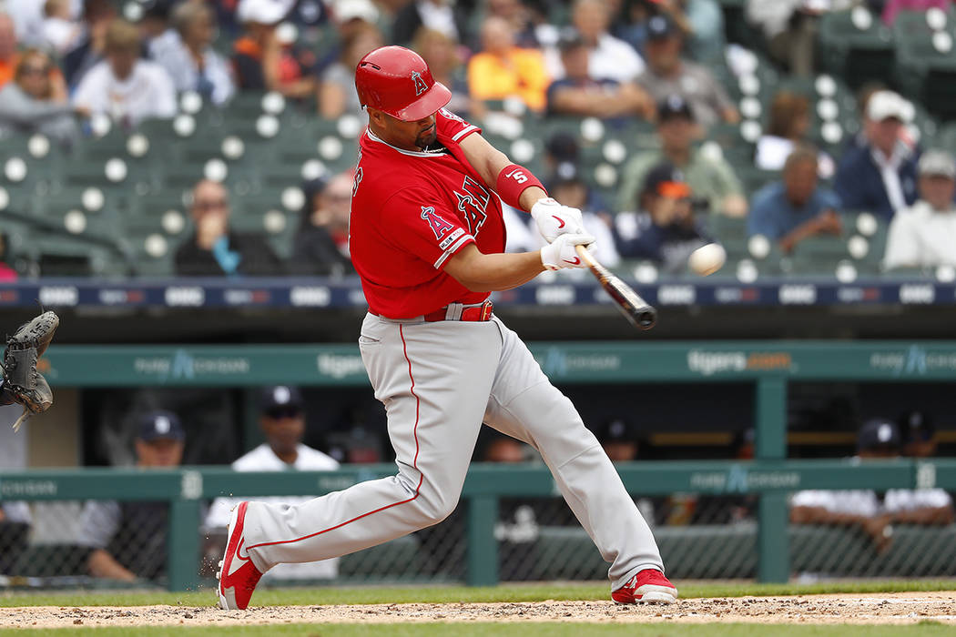 Los Angeles Angels' Albert Pujols hits a solo home run in the third inning of a baseball game a ...