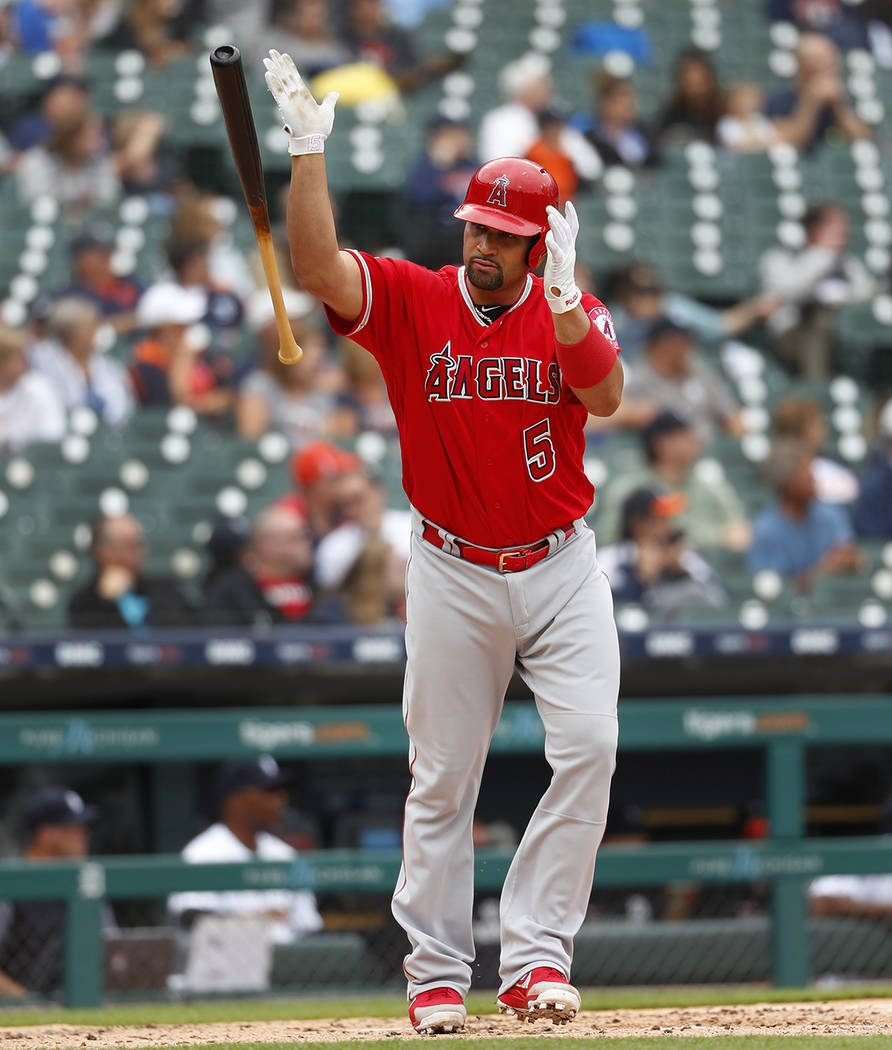 Los Angeles Angels' Albert Pujols tosses his bat after hitting a solo home run in the third inn ...