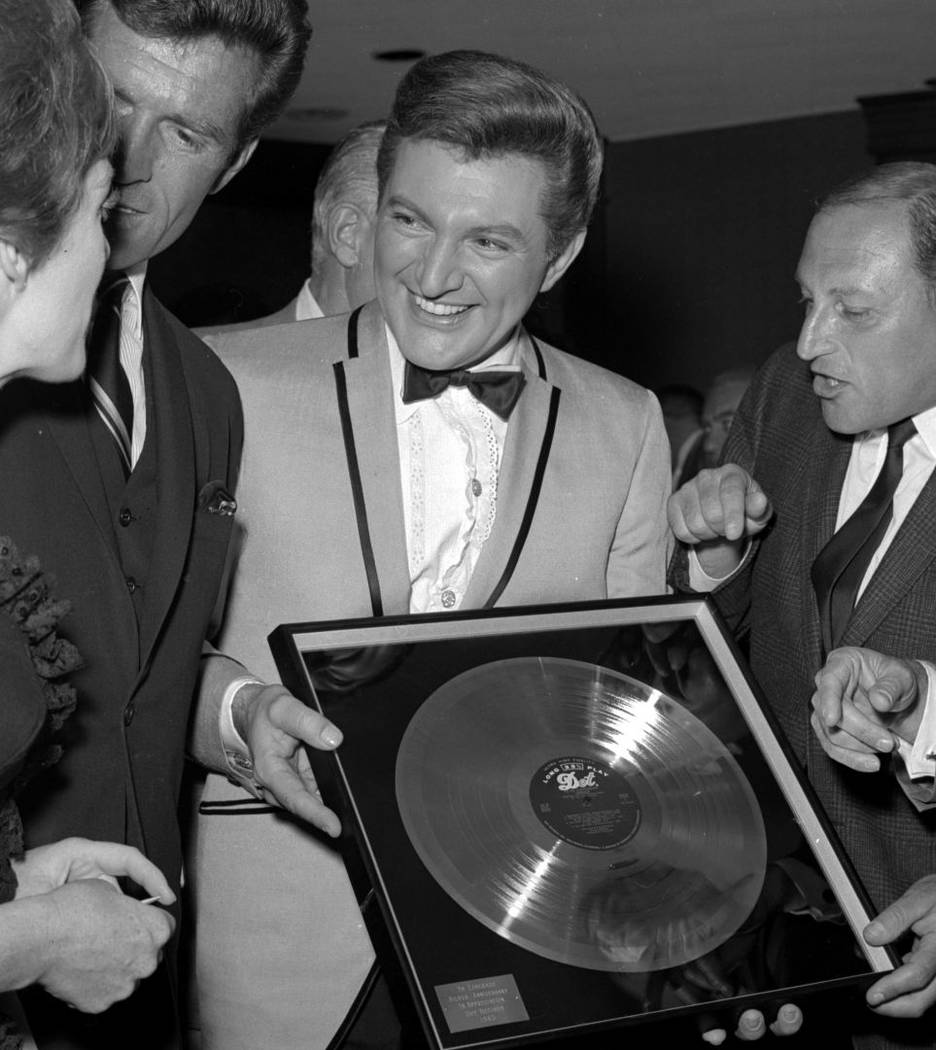 Liberace celebrates with his mother Frances at the Riviera for his 1965 Dot Silver Record on Se ...