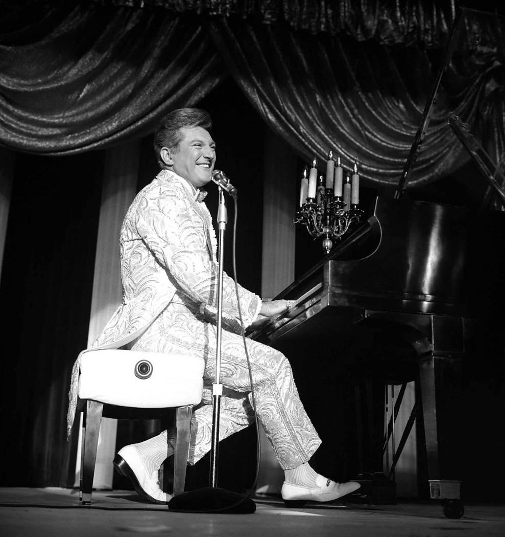 Liberace opening at the Sahara Hotel with Karen Wessler on June 21, 1966. (Las Vegas News Bureau)